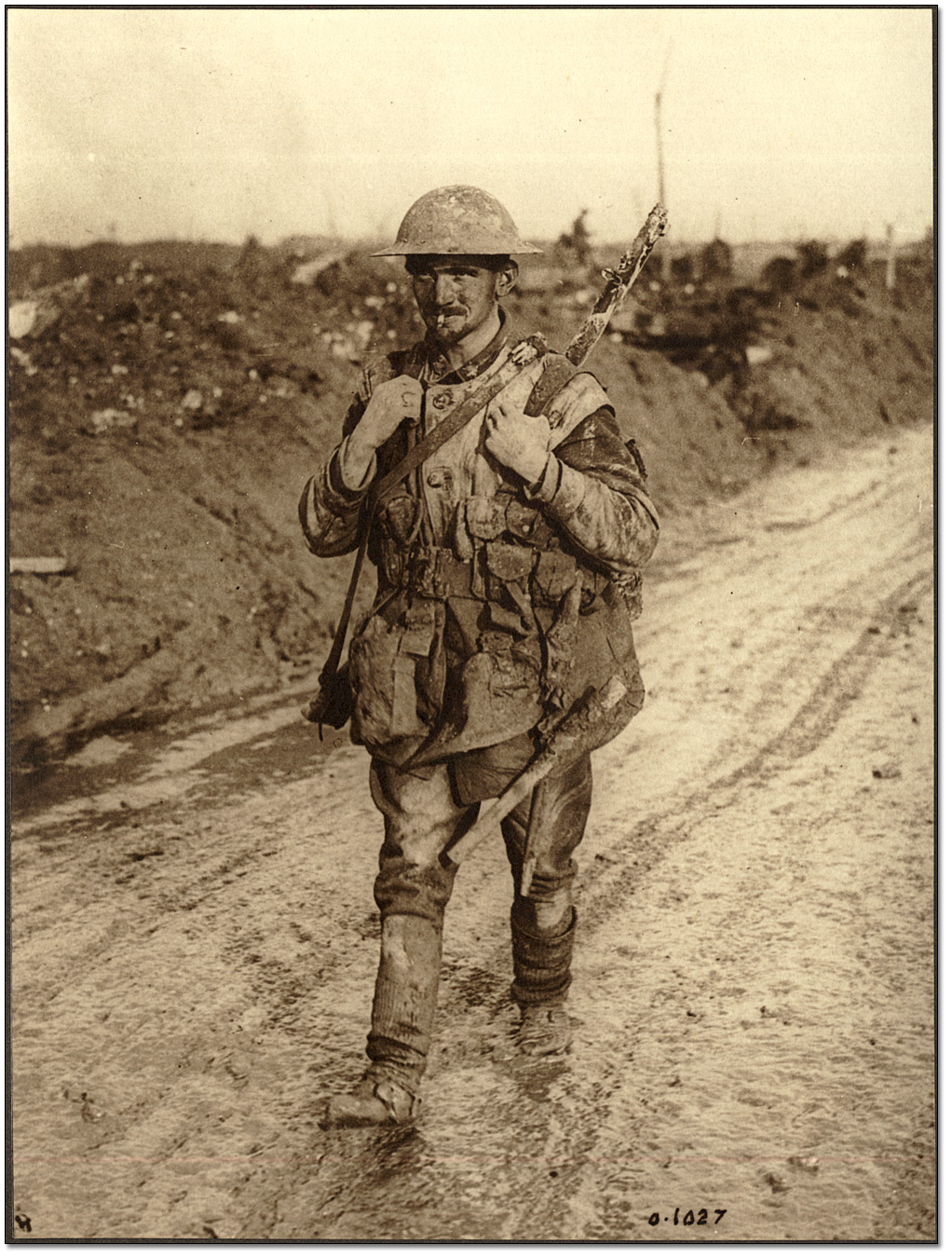 91359cdf6cdebd A Canadian Tommy soldier covered in mud returning from the front lines