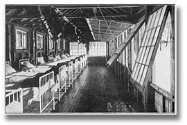 Photo: Interior view of Kendall Pavilion of the Muskoka Cottage Sanatorium, showing arrangement of glass front