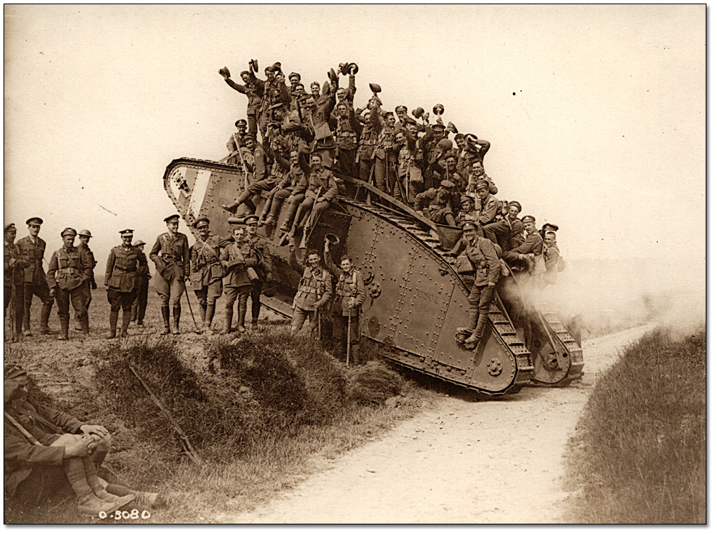 Canadians are seen returning on a tank 5th canadian mounted regiment