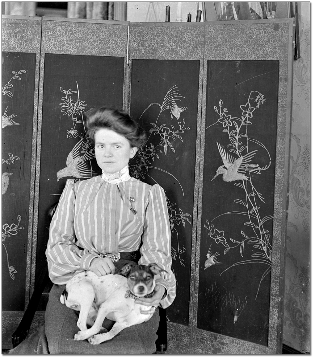 Portrait of an unidentified woman and her dog, [between 1898 and 1920]