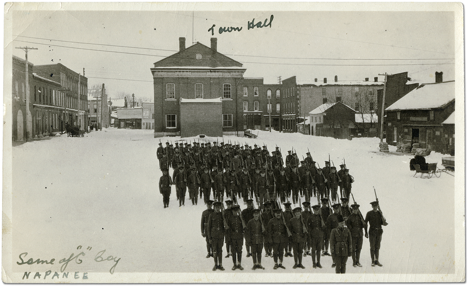 "Soldiers of the ""C"" Company, 80th Overseas Battalion, Canadian Expeditionary Force (C.E.F.) training in front of the town hall in Napanee, Ontario, [ca. 1914-1917]"