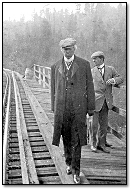 Sir Wilfrid Laurier by a railway track Date: 1910