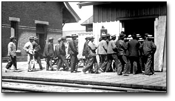 Photograph: Chinese immigrants entering Canada at the Sarnia tunnel, [189?]