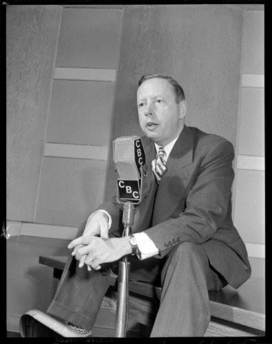 Foster Hewitt speaking into a CBC microphone, October 19, 1948