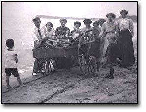 Family with Wagon on the Beach