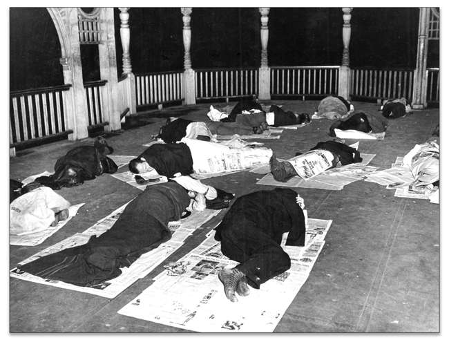 Unemployed workers sleeping in the bandstand at Queen's Park