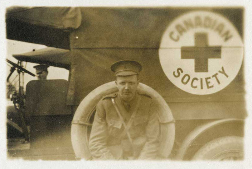 L Bruce Robertson beside Canadian Red Cross truck, ca. 1914-1918