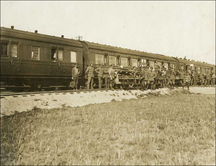 Wounded being lifted from the C.C.S. trucks to the Ambulance Train
