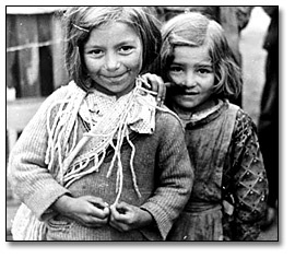 Photograph of two young Spanish girls looking to the camera