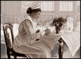 Detail of a photograph of a hospital ward room, focussing on a nurse writing on a chart
