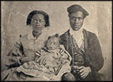 Tintype photographic portrait of black couple with their young baby