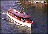 Detail of a photograph of a cruise boat motoring between islands